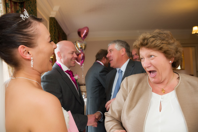 Wedding photography - having a laugh greeting the guests