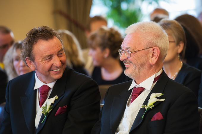 Wedding photograph of two happy fathers