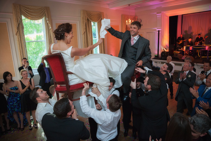 Wedding photograph - Jewish wedding celebrations with couple help aloft