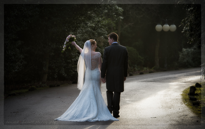 Wedding photograph of the bride and groom walking down a country lane