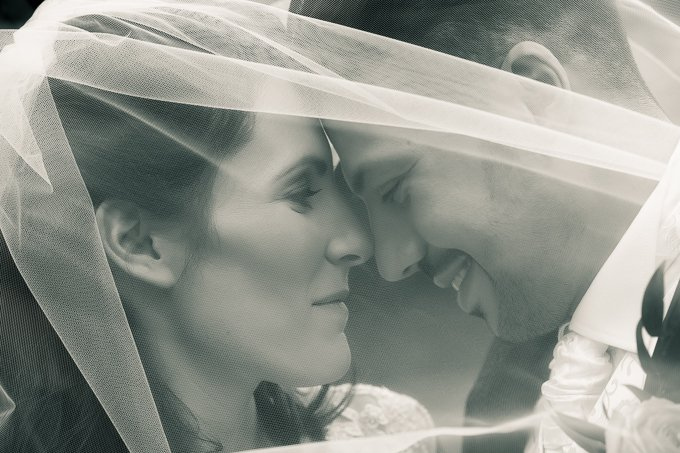Wedding photograph - bride and groom face to face smiling