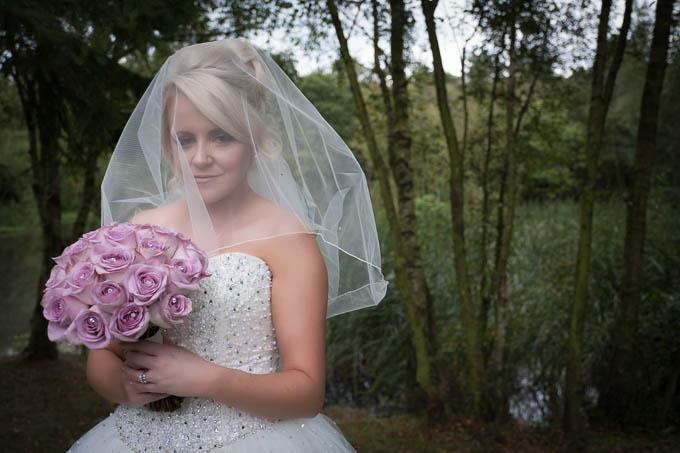 Wedding photography - Bride posing in woodlands