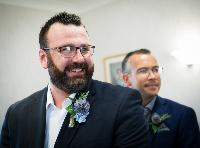 Wedding photograph of the groom smiling