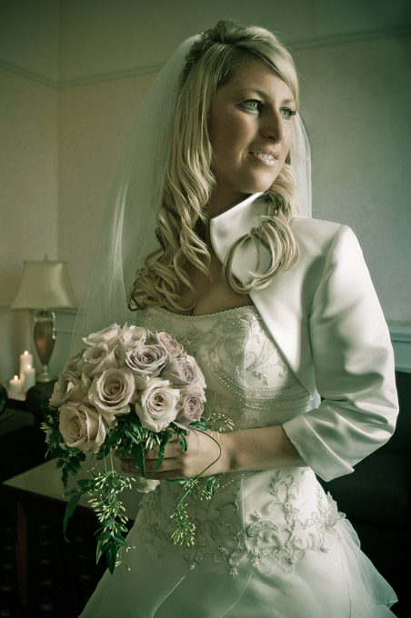 Wedding photograph - the bride posing with bouquet of pink roses