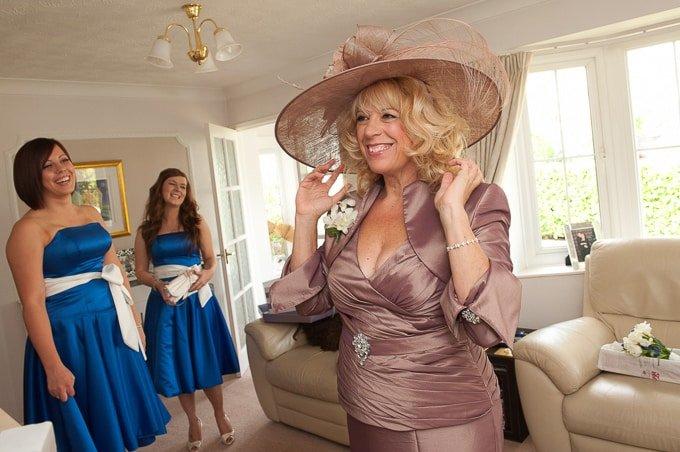 Wedding photography - the bride's mother adjusting her hat