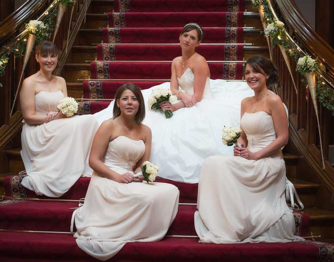 Wedding photography - 4 bridesmaids sitting on steps