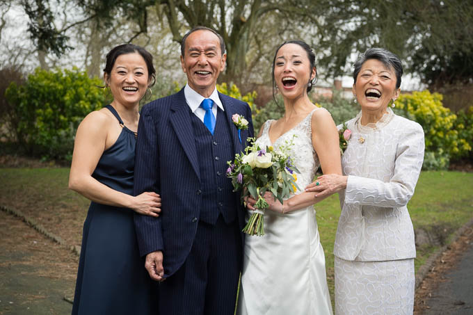 Wedding photograph in the gardens of the Old Swan - laughing family
