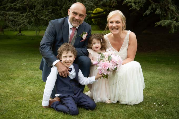 Wedding photography - couple posing with two children