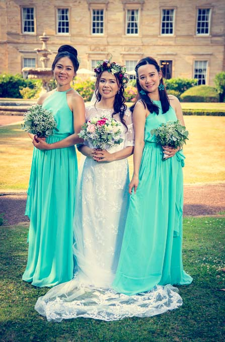 Wedding photography - Asian bride and bridesmaids in gardens of Oulton Hall, Leeds