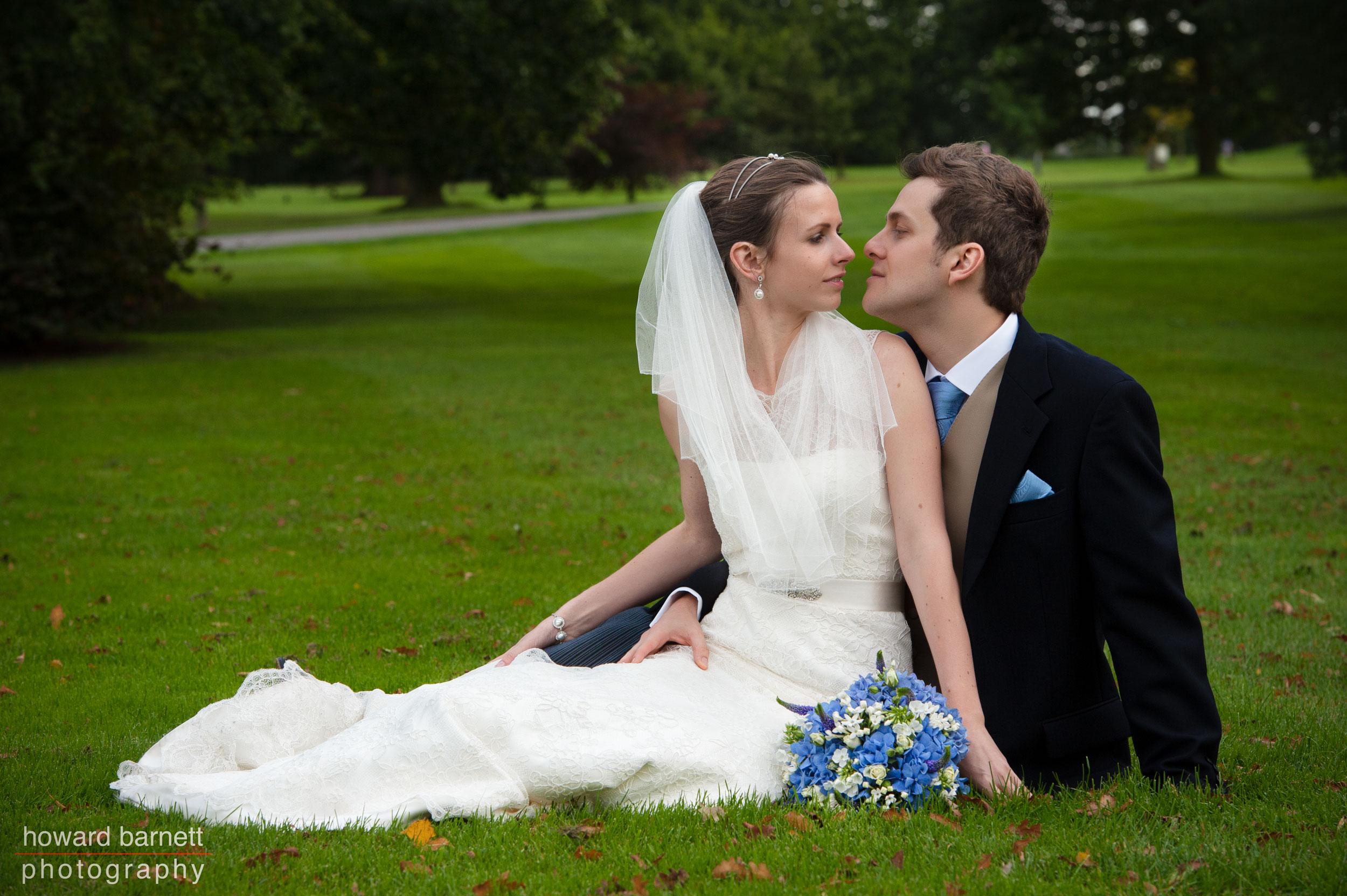 Wedding photograph - couple sitting in gardens
