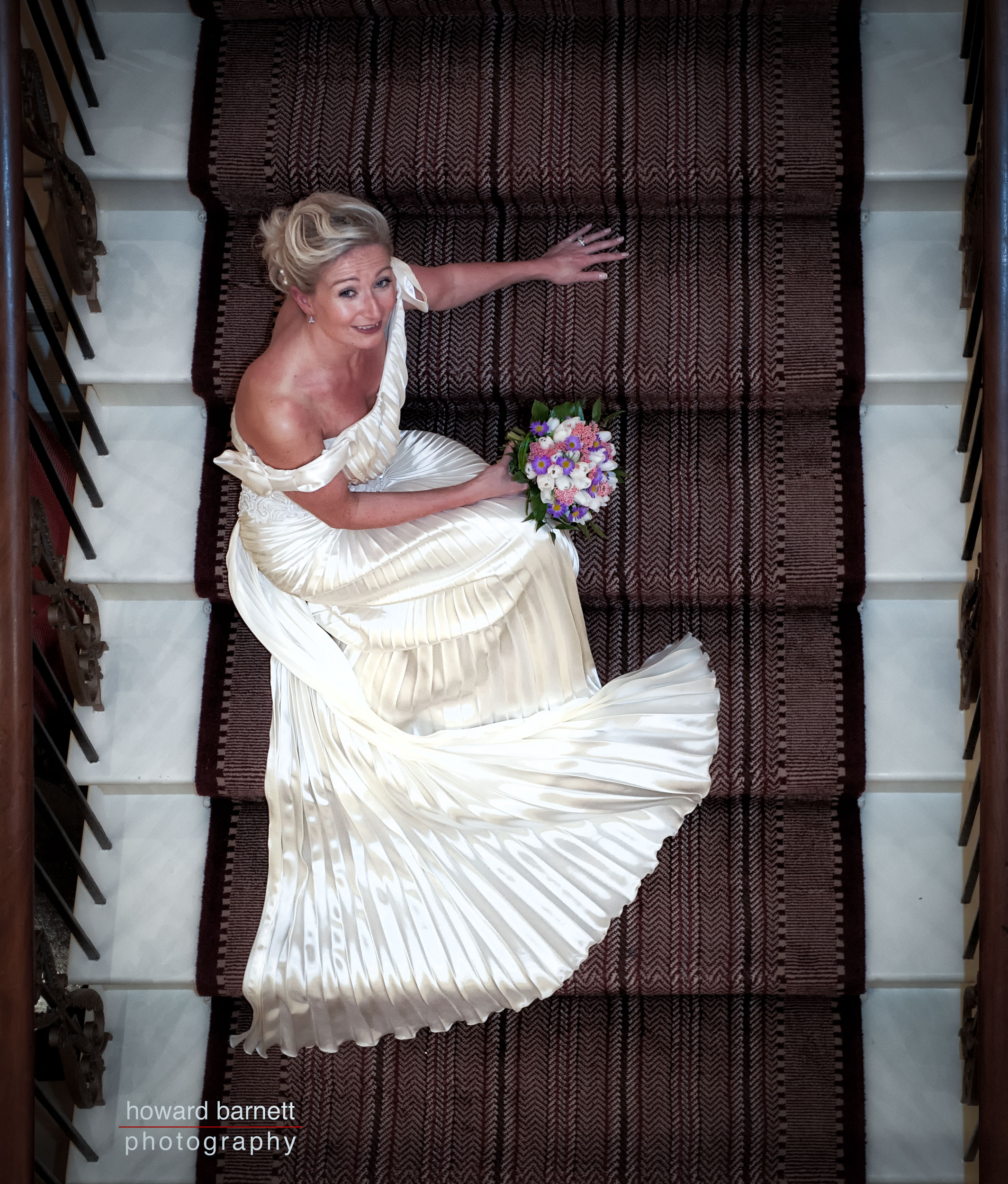 Rudding Park Wedding - bride sitting on the stairs